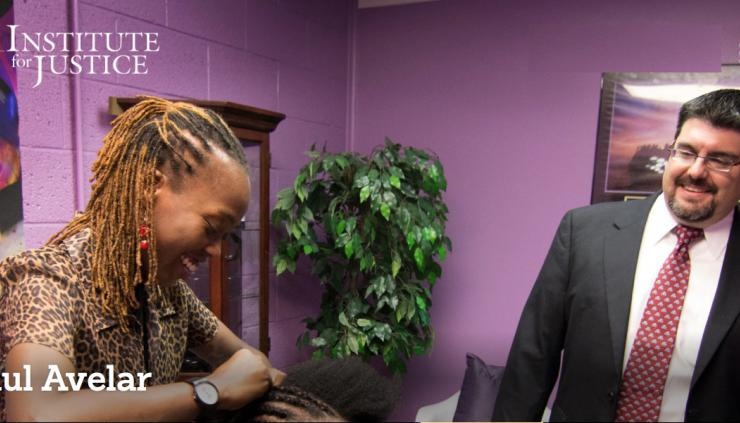 Paul Avelar (right) works with a the owner of an african hair braiding business.
