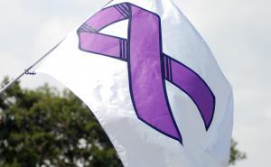 Domestic Violence Awareness flag waving