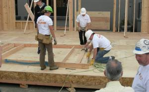 Habitat for Humanity volunteers working on a house