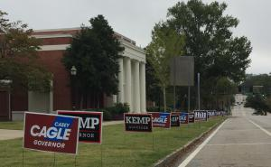 Campaign signs line Montgomery Street on the campus of Georgia College in Milledgeville.